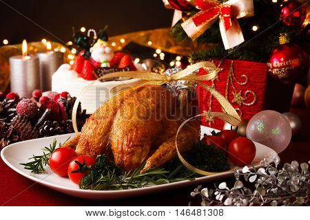Roasted chicken for Christmas. Christmas themed dinner table