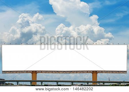 Big blank billboard against blue sky for new advertisement at Expressway.