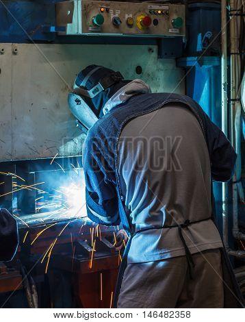 The Industrial steel welder  spark in factory.