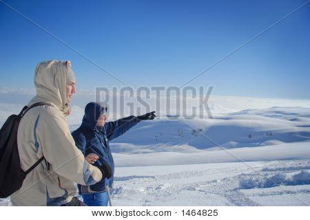 Explorers On A Mountain Top
