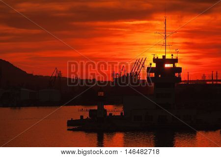 Cranes And Buildings Of Varna Port At Sunset