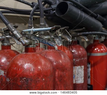 The Red fire extinguishers available in fire emergencies.