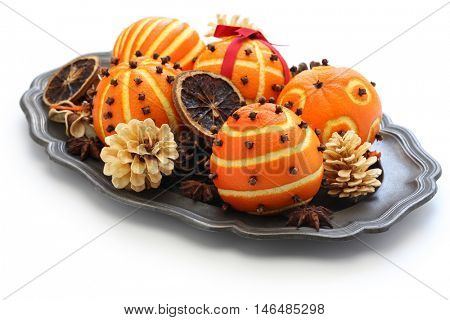 spiced orange pomander balls, scented christmas table decoration isolated on white background