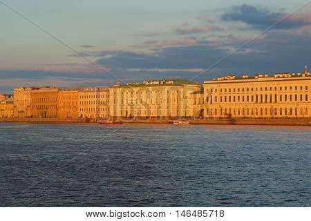SAINT PETERSBURG, RUSSIA - APRIL 24, 2016: Palace embankment in the setting sun of the april evening. Historical landmark of the city Saint Petersburg