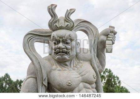 Statue Of A Chinese Warrior At The Buddhist Temple