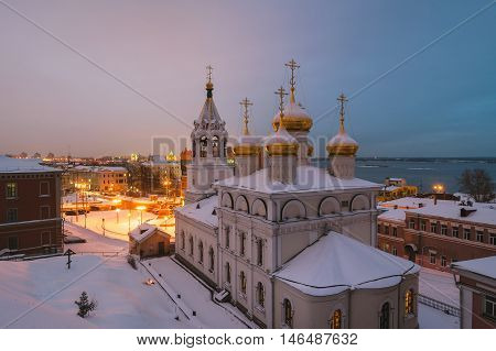 Aerial view of Church of the Nativity of John the Precursor in Nizhny Novgorod Russia at night in winter. Snow and colorful sunset sky