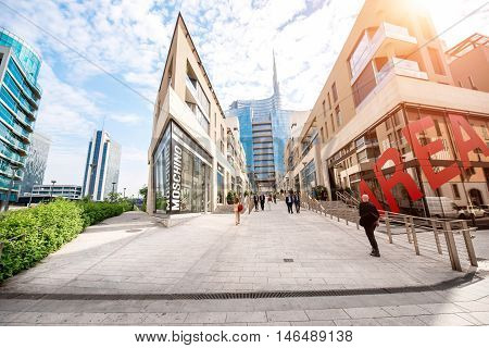 Milan, Italy - June 07, 2016: Vincenzo Capelli street with shopping boutiques and offices in Porta Nuova business district in Milan in the morning