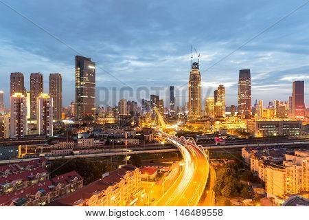 urban scene of tianjin in nightfallcity road and railway with modern buildingsChina