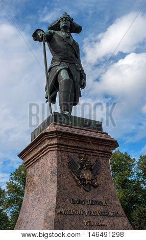 Gatchina, Russia - September 10, 2016: Monument to Russian Emperor Paul I in front of the Gatchina Palace. Paul I - Emperor and Autocrat of all the Russias 1796 - 1801. Behind the monument are the sundial.