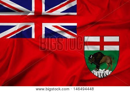 Waving Flag of Manitoba Province Canada, with beautiful satin background