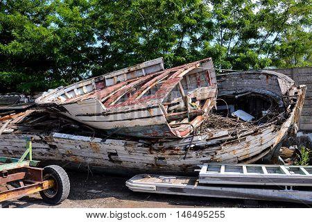 Old And Broken Wooden Boat Stranded