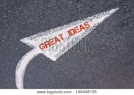 Directional White Painted Arrow With Words Great Ideas Over Road Surface