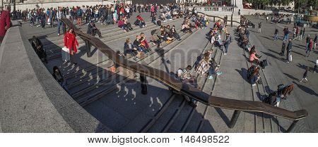 LONDON UK - CIRCA SEPTEMBER 2015: A crowd of people in Trafalgar Square seen with wide angle fish eye lens