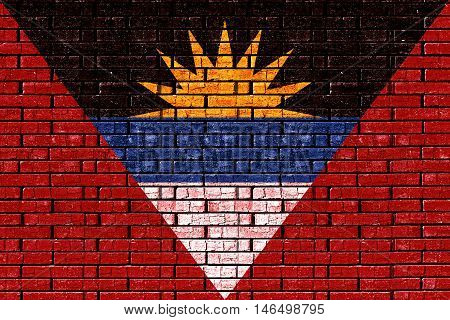 Illustration of the flag of Antigua and Barbuda looking like it is painted onto a wall