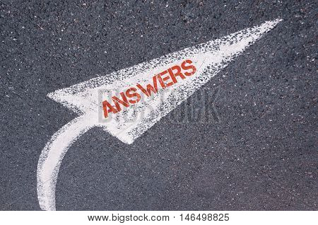 Directional White Painted Arrow With Word Answers Over Road Surface