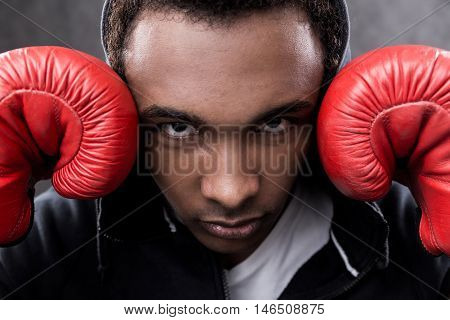African American Man With Boxing Gloves Looking To Camera