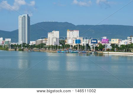 DANANG, VIETNAM - JANUARY 06, 2016: Urban waterfront of the Han river, sunny day. Tourist landmark of the city Da Nang