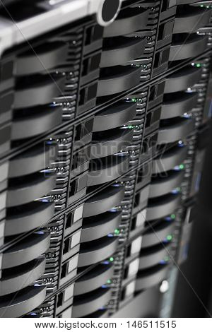 Closeup of storage area network storage hard drives in data center