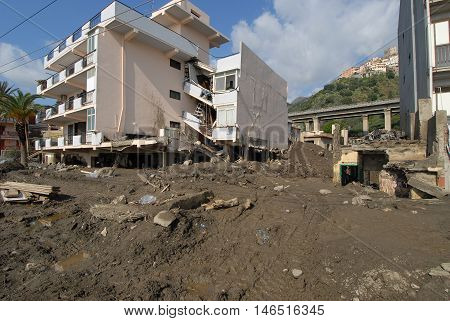 city hit by a landslide and a flood