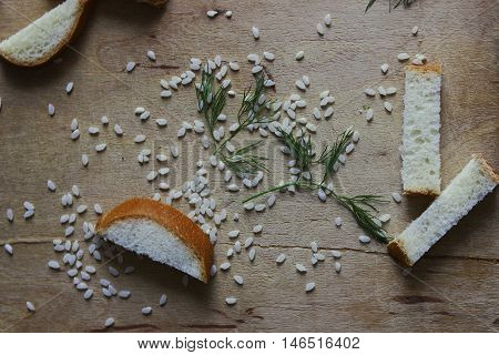 a mess of rice, white bread and green fresh herbs