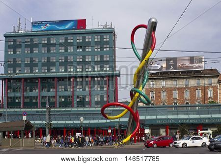 MILAN, ITALY - APRIL 16 2015: Overview of Piazza Cadorna in Milan with its public artwork Ago e Filo and Ferrovie Nord building and people around
