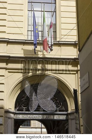 MILAN, ITALY - APRIL 16 2015: Entrance of the Societa incoraggiamento Arti e Mestieri in Milan Italy