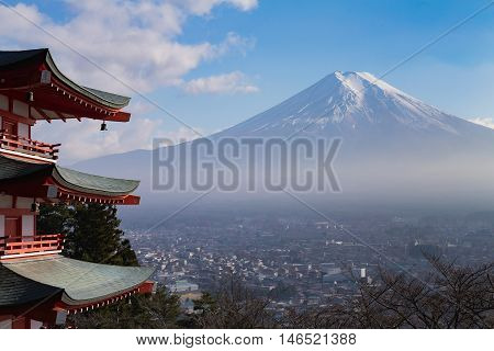 Fuji volcano mountain behind red pagoda aerial view city downtown, Japan