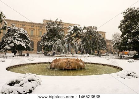 Piazza Bra (Bra square) during a snowfall in winter the most important square of Verona Italy (UNESCO world heritage site)