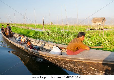 Inle Lake Myanmar - March 02 2011 : Intha traveling in a traditional long-tail boat in Inle Lake in the afternoon