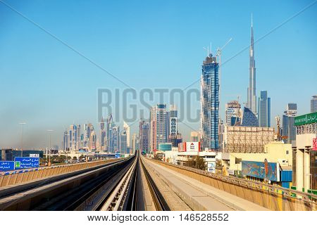 Dubai skyline shot from the driverless metro - in the background skyscrapers are seen including Burj Khalifa the tallest building in the world.