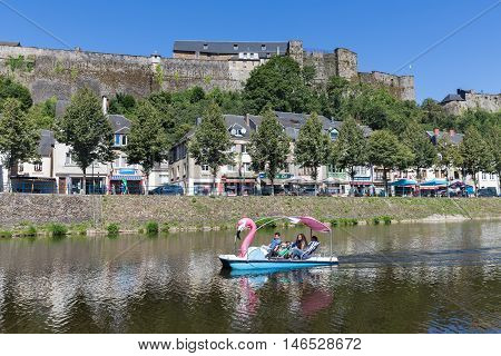 BOUILLON BELGIUM - AUG 13: Belgian medieval city with castle and people relaxing in pedalo at river Semois on August 13 2016 in Bouillon Belgium