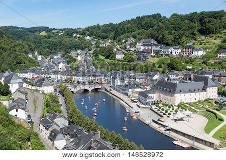 BOUILLON BELGIUM - AUG 13: Aerial view of medieval city Bouillon with pedalos in river Semois on August 13 2016 in Bouillon Belgium
