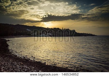 Sunset on the little bay of Brucoli summer in Sicily Italy