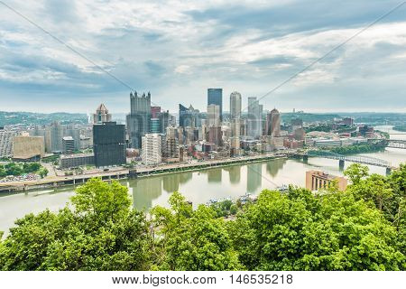 Pittsburgh, USA - June 3, 2016: Cityscape or skyline on the city from Washington Park with storm clouds