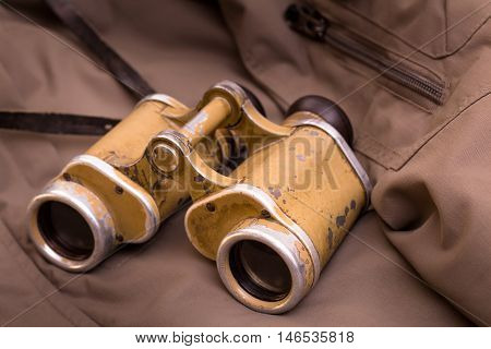 Old german military binocular glasses on fabric background