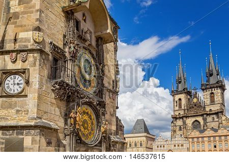 View of Prague Astronomical Clock and gothic Church of Our Lady Before Tyn in Old Town