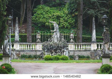 Sirmione Italy - May 09 2016: View of the garden of hotel Cortina Palace in rainy weather