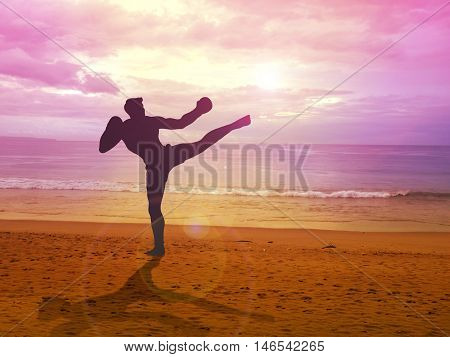 Silhouette illustration of a kick boxer training at the beach