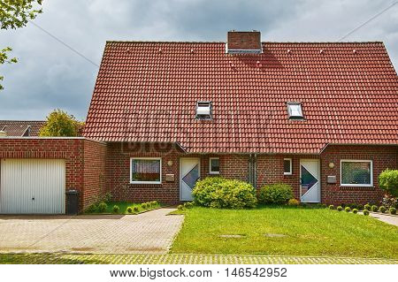 Image of Two-storey Red Brick House with Garage