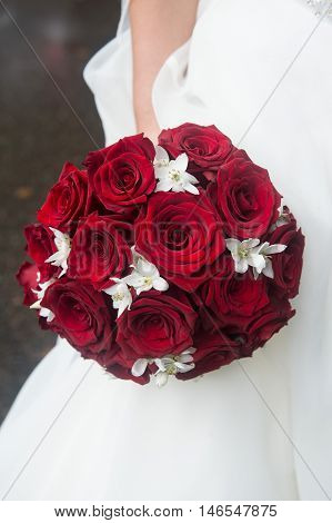 Wedding Bridal bouquet of red roses and white flowers. Floral