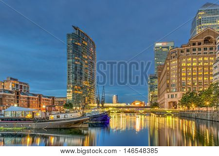 London United Kingdom - July 23 2016: West India Quay with historical warehouse boats and modern buildings in HDR