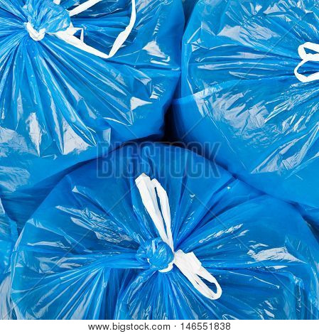 Three blue garbage bags as background. Environment.