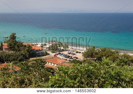 Beach in Afitos and summer resort at Kassandra of Halkidiki peninsula in Greece.