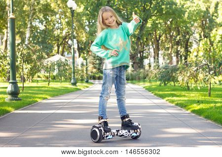 A Little Girl Riding A Electric Scooter . Personal Eco Transport ,gyro Scooter,smart Balance Wheel.