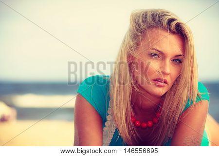 Blonde Woman Lying On Sand.
