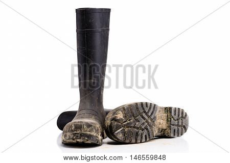 Dry dirty Mud boots isolated on pure white background fallen