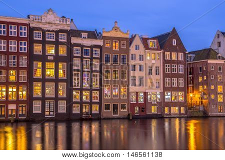 Canal Houses On Damrak In Amsterdam