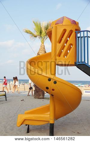 orange toboggan in a recreation area at the beach
