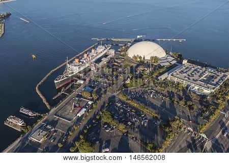Long Beach, California, USA - August 16, 2016:  Afternoon aerial view of the Queen Mary and neighboring cruise ship terminal dome in Long Beach Harbor.