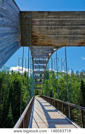 Curved wooden bridge in Ouimet Canyon near Thunder bay